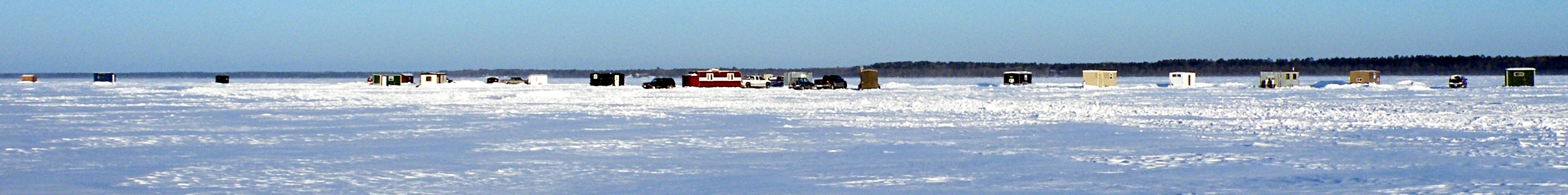 Ice fishing houses on Lake Bemidji in Minnesota (2008) Photo by Matthew Stinar - CC BY-2.0