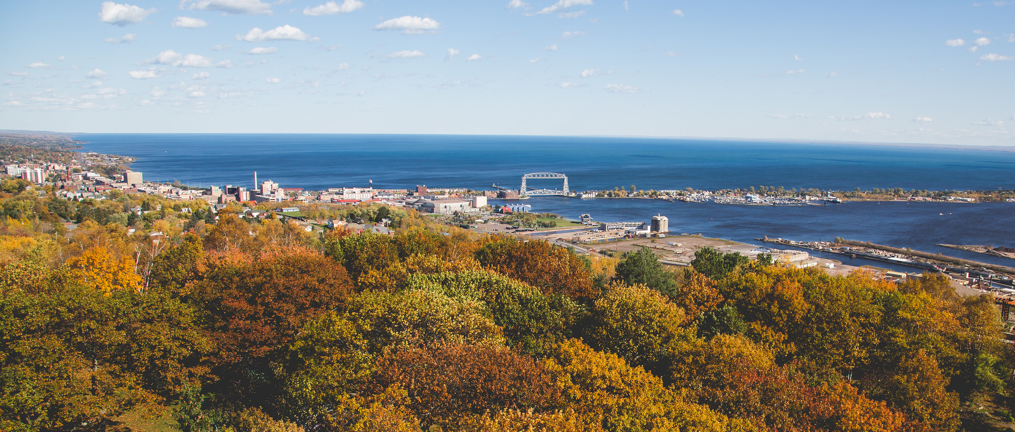 The view from Enger Tower: autumn colors, the Duluth Lift Bridge, the Duluth skyline, and Lake Superior
